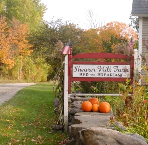 Fall foliage Shearer Hill Farm sign.